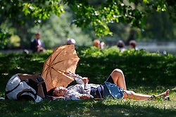 © Licensed to London News Pictures. 04/06/2015. London, UK. People enjoying the sunshine and warm weather in St James's Park in London on Thursday, 4 June 2015 as temperature hits 22C. Photo credit: Tolga Akmen/LNP