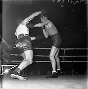 26/01/1962<br /> 01/26/1962<br /> 26 January 1962<br /> Irish Amateur National Junior Boxing Championships, at the National Stadium, Dublin. J. Fairbrother, (right) St. Francis B.C., Limerick puts M. O'Donovan, Matt Talbot B.C. Cork, off balance with a left to the side of the body during the Middleweight Final. Fairbrother won the bout when the referee stopped the contest in the 3rd round.
