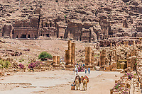 Petra, Jordan - May 10, 2013: tourists visiting The Hadrien Gate roman avenue in Petra Jordan on may 10th, 2013