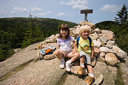 Two young hikers on the South Bubble in Acadia National Park Maine USA