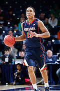 SOUTH BEND, IN - JANUARY 28: Malcolm Brogdon #15 of the Virginia Cavaliers brings the ball up court during the game against the Notre Dame Fighting Irish at Purcell Pavilion at the Joyce Center on January 28, 2014 in South Bend, Indiana. Virginia won the game 68-53. (Photo by Joe Robbins)