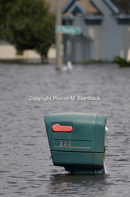 A home mailbox is inundated with water on a neighborhood street flooded by the heavy rains from Tropical Storm Fay in Debary, Florida, Wednesday, Aug. 27, 2008.