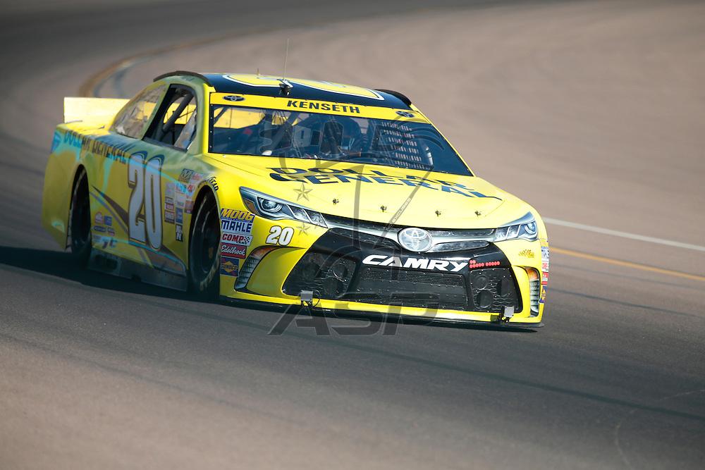 Avondale, AZ - Oct 14, 2015:  Matt Kenseth (20) brings his race car through the turns during the NASCAR Test at the Phoenix International Raceway in Avondale, AZ.