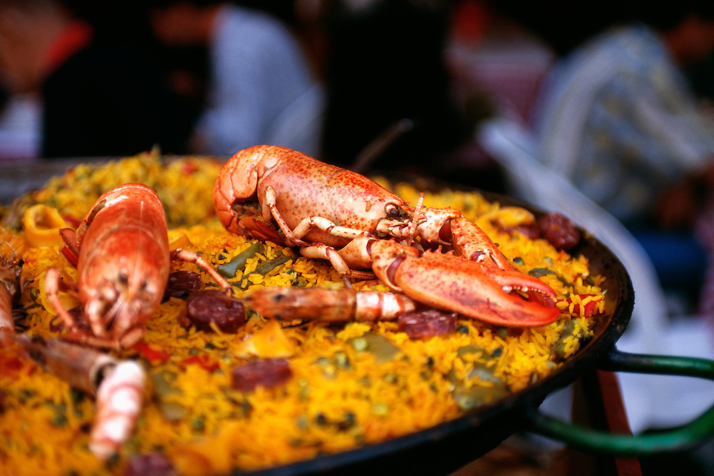 France, Toulon, Provence, seafood paella at waterfront restaurant.