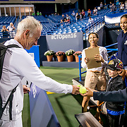 August 25, 2016, New Haven, Connecticut: <br /> John McEnroe signs autographs for an auction winner during the Men's Legends Event on Day 7 of the 2016 Connecticut Open at the Yale University Tennis Center on Thursday, August  25, 2016 in New Haven, Connecticut. <br /> (Photo by Billie Weiss/Connecticut Open)