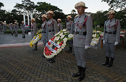 Image shows Philippine Army honour guard at the ANZAC Day 2015 Centenary Service at The Tomb of the Unknown Soldier, Fort Bonifacio, Manila.<br /> 25/04/2015.<br /> <br /> Credit should read: Cpl Mark Larner RY<br /> <br /> Image shows general view of the ANZAC Day 2015 Centenary Service at The Tomb of the Unknown Soldier, Fort Bonifacio, Manila.<br /> 25/04/2015.<br /> <br /> Credit should read: Cpl Mark Larner RY.<br /> <br /> As the sun rose over the Philippines this morning, 38 members of a British military unit stood along side fellow service personnel from across the globe to mark the 100th anniversary of Anzac Day.<br /> <br /> Soldiers and officers from 77 Brigade joined Australian, New Zealand, Canadian and Filipino comrades at Manila&rsquo;s Libingan ng mga Bayani (Tomb of the Unknown Soldiers) at Fort Bonifacio in Taguig City for a service of remembrance.<br /> <br /> The commemorations were also attended by the Australian, New Zealand and Turkish ambassadors, the British Embassy Deputy Head of Mission and other dignitaries.