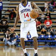 Delaware 87ers Forward Malcolm Lee (14) dribbles the ball up court in the first half of a NBA D-league regular season basketball game between the Delaware 87ers and the Westchester Knicks (New York Knicks) Sunday, Dec. 28, 2014 at The Bob Carpenter Sports Convocation Center in Newark, DEL