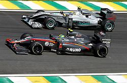 Motorsports / Formula 1: World Championship 2010, GP of Brazil, 21 Bruno Senna (BRA, HRT F1 Team), 04 Nico Rosberg (GER, Mercedes GP Petronas),