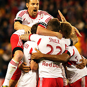 Heath Pearce, (top), joins in the celebrations after a goal from Jonny Steele, (22), New York Red Bulls, who celebrates with team mates during the New York Red Bulls V New England Revolution, Major League Soccer regular season match at Red Bull Arena, Harrison, New Jersey. USA. 20th April 2013. Photo Tim Clayton