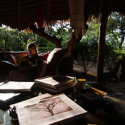 Julie Stabler Hull relaxes in the library at Elephant Watch Camp in Samburu National Reserve, Kenya