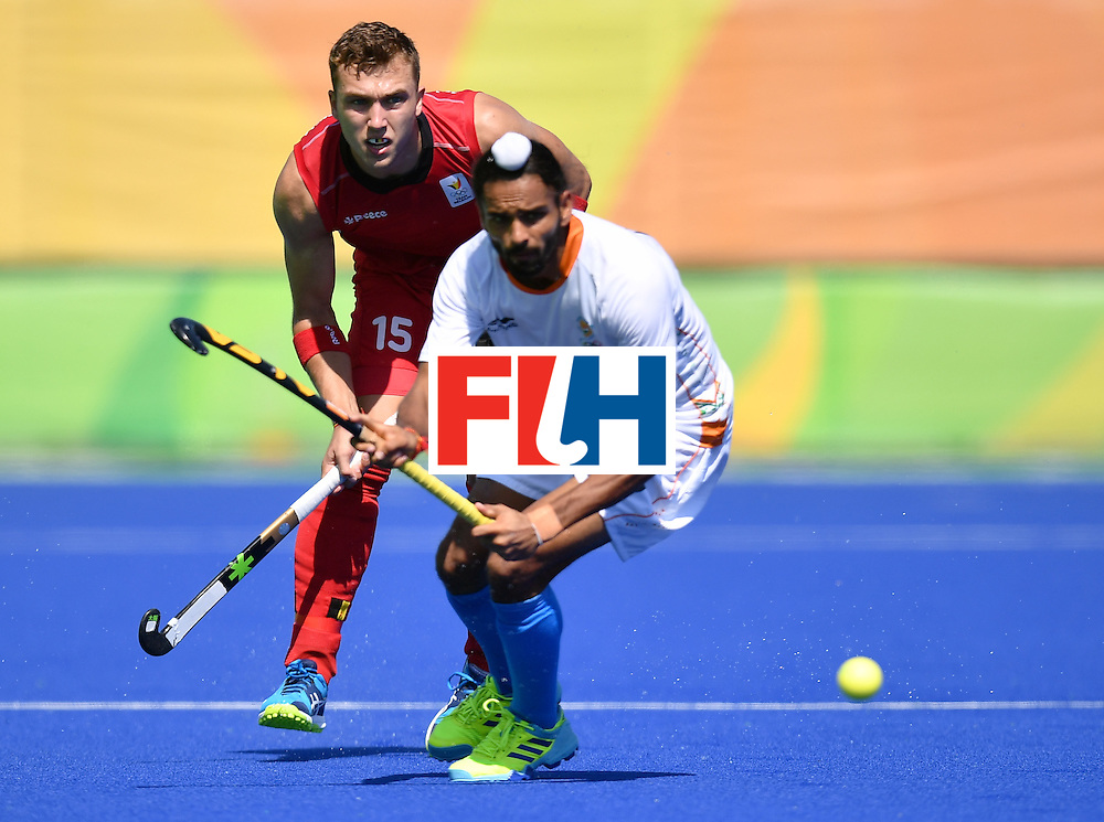 Belgium's Emmanuel Stockbroekx (L) vies with India's Akashdeep Singh during the men's quarterfinal field hockey Belgium vs India match of the Rio 2016 Olympics Games at the Olympic Hockey Centre in Rio de Janeiro on August 14, 2016. / AFP / MANAN VATSYAYANA        (Photo credit should read MANAN VATSYAYANA/AFP/Getty Images)