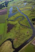 Nederland, Drenthe, Gemeente Anloo, 08-09-2009; riviertje de Hunze, ten Westen van Spijkerboor met het Annermoeras, herstel van de oude loop van de beek, de meanders maken weer deel uit van de waterhuishouding en er is ruimte gemaakt voor waterberging. De vroegere kanalisatie (uit de tijd van de ruilverkaveling) is nog zichtbaar.Hunze river, with newly created swamp, restoration of the old course of the river has been restored, the meanders are again part of the water and there is space for water storage. The former channeling (from the time of land consolidation) is still visible.luchtfoto (toeslag); aerial photo (additional fee required); .foto Siebe Swart / photo Siebe Swart