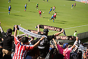 Members of the Black Army supporters group cheer and hold up scarves during the final game of the Chivas USA franchise at the StubHub Center in Carson, Calif., on Oct. 26, 2014.