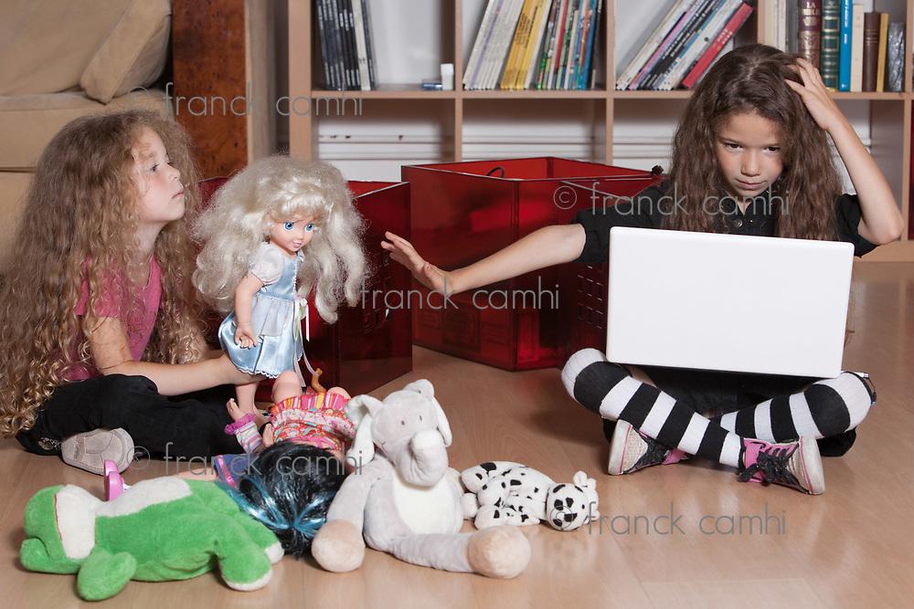 caucasian little girl computing refuse playing isolated studio