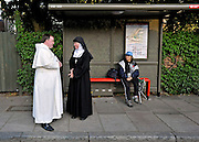 Religious Pilgrims stand at a bus stop on 17th September 2010 next to the entrance to St Mary's University, London, ahead of the arrival of Pope Benedict XVI as he visits St Mary's University in Twickenham for a Celebration of Roman Catholic education. © under license to London News Pictures.