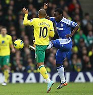 Picture by Paul Chesterton/Focus Images Ltd.  07904 640267.21/01/12.Simeon Jackson of Norwich and Michael Essien of Chelsea in action during the Barclays Premier League match at Carrow Road Stadium, Norwich.