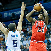 03 November 2015: Chicago Bulls guard Jimmy Butler (21) takes a jump shot over Charlotte Hornets forward Nicolas Batum (5) during the Charlotte Hornets  130-105 victory over the Chicago Bulls, at the Time Warner Cable Arena, in Charlotte, North Carolina, USA.