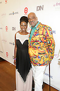Water Mill, New York: (L-R) Tangie Murray, Executive Director, RUSH Philanthropic Arts Foundation and Visual Artist Danny Simmons attend the RUSH Philanthropic Arts Foundation 15th Annual Art For Life Benefit Gala held in the Hamptons at the Farmview Farms on July 26, 2014  in Water Mill, New York. (Terrence Jennings)
