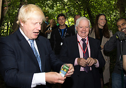 Shooters Hill, London, uly 30th 2015. Mayor of London Boris Johnson celebrates 100,000 Team London volunteers in his project to mobilise an army of volunteers across the capital to undertake youth projects aimed at reducing crime. The Wide Horizon project icorporates volunteers from thius undertaking and the Mayor was shown first hand how the project has enabled the Wide Horizon's Adventure Training centre to add another facility to engage and educate children and youths. PICTURED: Mayor Boris Johnson is shown around the Wide Horizons Woodland project.