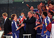 UEFA European Championship 2000.France captain Didier Deschamps receives the trophy from UEFA president Lennart Johansson.©Juha Tamminen