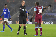 Referee David Coote tries to calm Michail Antonio (30)during the Premier League match between Leicester City and West Ham United at the King Power Stadium, Leicester, England on 22 January 2020.