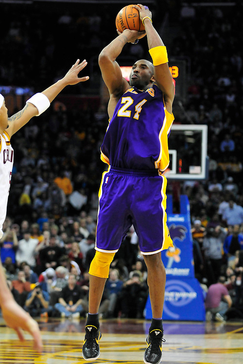 Feb. 16, 2011; Cleveland, OH, USA; Los Angeles Lakers shooting guard Kobe Bryant (24) shoots over Cleveland Cavaliers small forward Jamario Moon (15) during the fourth quarter at Quicken Loans Arena. The Cavaliers beat the Lakers 104-99. Mandatory Credit: Jason Miller-US PRESSWIRE