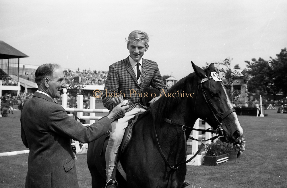 "08/08/1967<br /> 08/08/1967<br /> 08 August 1967<br /> R.D.S. Horse Show, Ballsbridge, Dublin. Photo shows Kenneth Scott, Lisdoonan, Saintfield, Co. Down, on ""Rolo"" winner of competition A (Children) receiving his prize from Mr. Michael O'Brien RDSH judge."