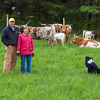 Bryan and Cathy Gilvesy, of YU Ranch, and their Texas Long Horn cattle.