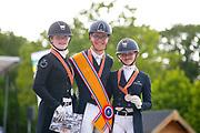 Podium Junioren 1. Marten Luiten - Fynona, Sanne van der Pols - Excellentie, 3. Micky Schelstraete - Grand Charmeur<br /> NK Dressuur 2019<br /> © DigiShots