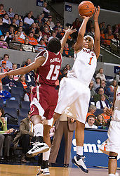Virginia forward Lyndra Littles (1) shoots over Rider forward Shaunice Parker (15).  The #15 ranked Virginia Cavaliers defeated the Rider Broncs 83-38 in the Marriott Cavalier Classic Basketball Tournament at the John Paul Jones Arena on the Grounds of the University of Virginia in Charlottesville, VA on December 28, 2008.