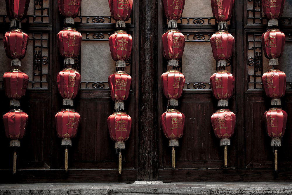 Lamps adorn a wall at an historic residence of a salt merchant now open to the public in Yangzhou, China, a suburb city of Shanghai and major producer of photovoltaic cells for solar power.