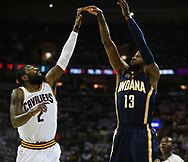 April 17, 2017 - Cleveland, OH, USA - Cleveland Cavaliers guard Kyrie Irving is short in defending Indiana Pacers forward Paul George's three-pointer during the first quarter in Game 2 of an Eastern Conference playoff game on Monday, April 17, 2017, at Quicken Loans Arena in Cleveland, Ohio. (Credit Image: © Leah Klafczynski/TNS via ZUMA Wire)
