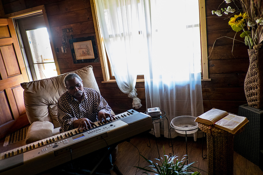 "Donald ""Amzi"" Lightner, 63, plays music in his home in Clairton, Pa."
