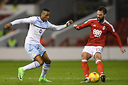 Aston Villa forward Jonathan Kodjia (26) battles with Nottingham Forest defender Danny Fox (13) during the EFL Sky Bet Championship match between Nottingham Forest and Aston Villa at the City Ground, Nottingham, England on 4 February 2017. Photo by Jon Hobley.
