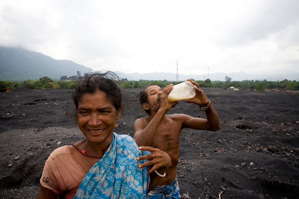 Villagers sift through waste from chromite-ore mines in search of scraps to sell back to merchants. Many of them have been surviving this way for over 20 years. Sukinda, Orissa, India