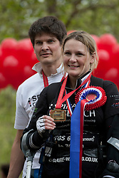 © licensed to London News Pictures. London, UK 08/05/2012. Claire Lomas, who paralysed from the chest down after an accident, finishes the London Marathon and posing with her husband Dan Spincer and her medal, today after 16 days with a robotic suit to raise money for Spinal Research (08/05/12). Photo credit: Tolga Akmen/LNP