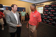 Ole Miss athletic director Ross Bjork (left) talks with Brian O'Neal, who was named the new track coach at Ole Miss during a press conference in Oxford, Miss. on Tuesday, June 12, 2012.