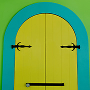 Brightly painted shuttered doorways on store in Cruz Bay