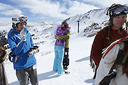 SHOT 2/14/11 1:22:20 PM - Loveland Ski Area in Colorado hosted the 20th Annual Marry Me & Ski Free Mountaintop Matrimony on Valentine's Day Monday, February 14th. The mass wedding ceremony was held at noon at 12,050 feet outside of the Ptarmigan Roost Cabin at Loveland. More than 75 couples were pre-registered to get married or renew their vows high on The Continental Divide in this yearly Loveland tradition.  Following the ceremony couples were invited to a casual reception complete with a champagne toast, wedding cake and music.  (Photo by Marc Piscotty / © 2010)