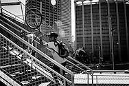 Sao Paulo, Brazil, Thursday - March 08, 2012: A biker carries his bike upstairs to cross Marginal Pinheiros avenue.  (photo: Caio Guatelli)