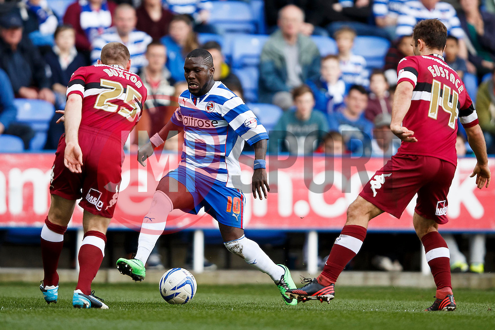 Reading Defender Royston Drenthe (NED) is challenged by Derby Defender Jake Buxton (ENG) and Midfielder John Eustace (ENG) - Photo mandatory by-line: Rogan Thompson/JMP - 07966 386802 - 15/09/2014 - SPORT - FOOTBALL - Madejski Stadium - Reading - Reading v Derby County - Sky Bet Football League Championship.