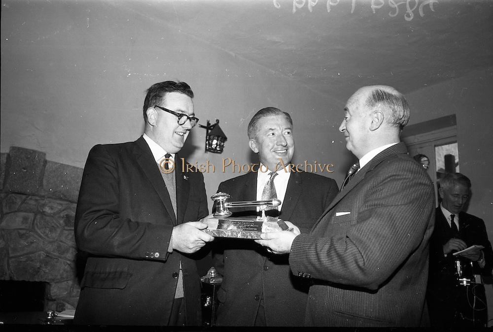 24/05/1966<br /> 05/24/1966<br /> 24 May 1966<br /> Players and Wills trophies presented for Gaelic League Inter Branch Debating Competition. Mr. P.J. Lavery, Director of Player and Wills (Ireland) Ltd. handed over a set of solid silver trophies and cheques to Cathal Ó Feinneadha, Uachtarain, Conradh na Gaeilge, for an All Ireland gaelic League Inter-Branch Debating Competition The presentation took place at the new Conradh na Gaeilge headwaters at Harcourt Street, Dublin. Picture shows Mr. Lavery (right) handing over the major trophy to Mr. Ó Feinneadha with Mr. Risteard O Donnabhain (centre), Roinn na Gaelteachta).