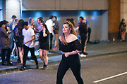 MANCHESTER 19.09.2017 A  woman walk in the middle of the road<br /> <br /> Freshers week continues in Manchester which has seen 1000s of students out drinking every night since Sunday.