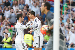 25.10.2014, Estadio Santiago Bernabeu, Madrid, ESP, Primera Division, Real Madrid vs FC Barcelona, 9. Runde, im Bild Real Madrid´s Cristiano Ronaldo celebrates a goal with Isco // during the Spanish Primera Division 9th round match between Real Madrid CF and FC Barcelona at the Estadio Santiago Bernabeu in Madrid, Spain<br /> <br /> ***** NETHERLANDS ONLY *****