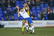 Luke O'Neill of Wimbledon and Paul Mullin of Tranmere Rovers contest a loose ball  during the EFL Sky Bet League 1 match between Tranmere Rovers and AFC Wimbledon at Prenton Park, Birkenhead, England on 21 December 2019.