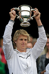 LONDON, ENGLAND - Saturday, July 2, 2011: Luke Saville (AUS) celebrates with the trophy after winning the Boys' Singles Final on day twelve of the Wimbledon Lawn Tennis Championships at the All England Lawn Tennis and Croquet Club. (Pic by David Rawcliffe/Propaganda)