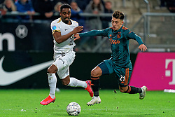 Gyrano Kerk #7 of FC Utrecht and Lisandro Martinez #21 of Ajax in action during the semi final KNVB Cup between FC Utrecht and Ajax Amsterdam at Stadion Nieuw Galgenwaard on March 04, 2020 in Amsterdam, Netherlands