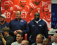 Ole Miss assistant coach Keith Burns (left) and defensive coordinator Tyrone Nix attend head coach Houston Nutt's news conference Monday, Nov. 7, 2011 at the University of Mississippi in Oxford, Miss. Nutt will resign at the end of the season.