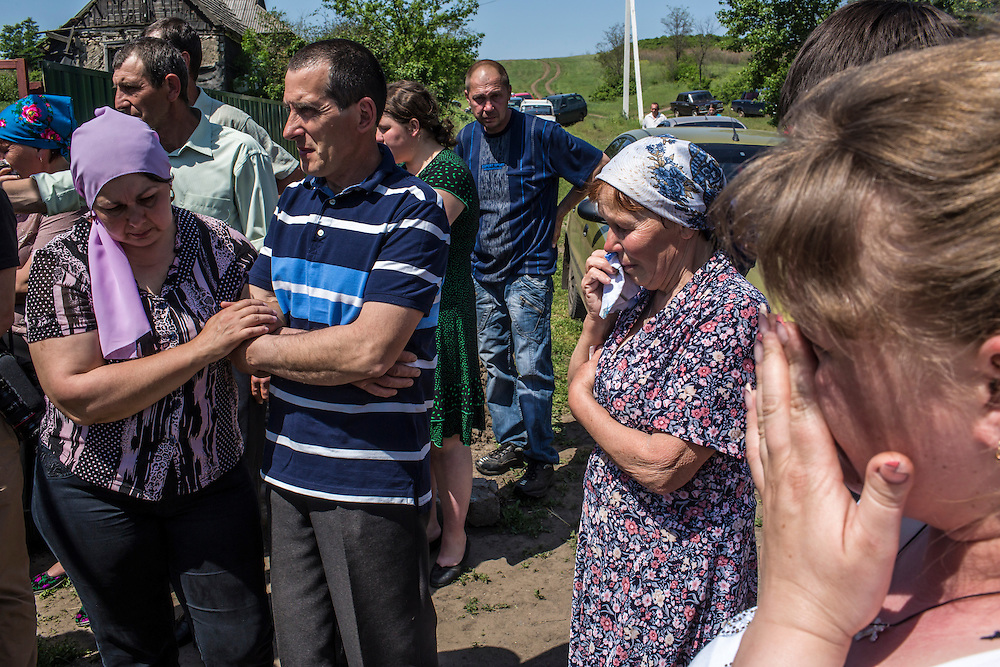 STAROVARVAROVKA, UKRAINE - MAY 16:  Mourners attend the funeral of Elena Ott, 42, on May 16, 2014 in Starovarvarovka, Ukraine. Ott was killed two days prior when the car she was riding in was fired on by forces her family believes to be the Ukrainian military. (Photo by Brendan Hoffman/Getty Images) *** Local Caption ***