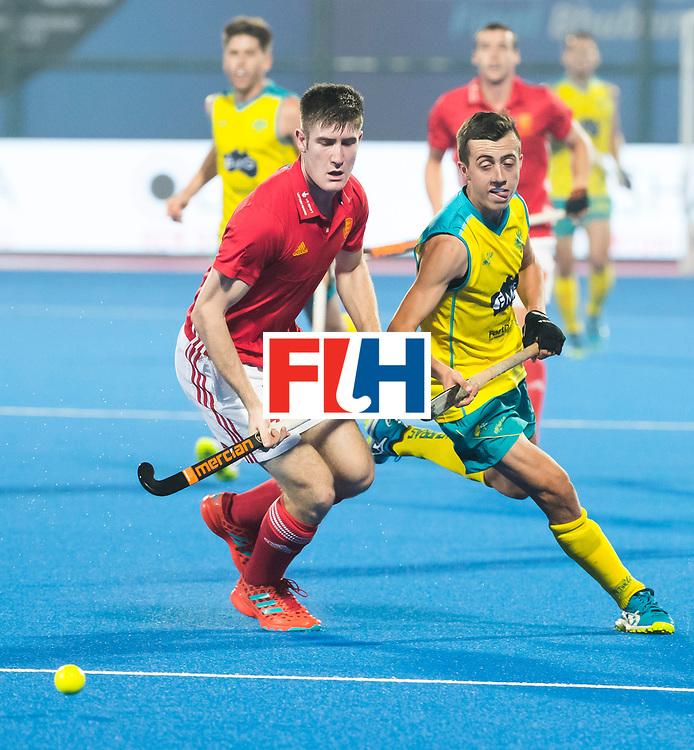 BHUBANESWAR - The Odisha Men's Hockey World League Final . Match ID 09 .  Australia v England  . Lachlan Sharp (Aus) with  Liam Sanford (Eng)    WORLDSPORTPICS COPYRIGHT  KOEN SUYK